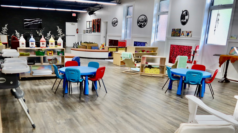Our EarlyON centre at the Kitchener location with toys, art supplies, tables and chairs.