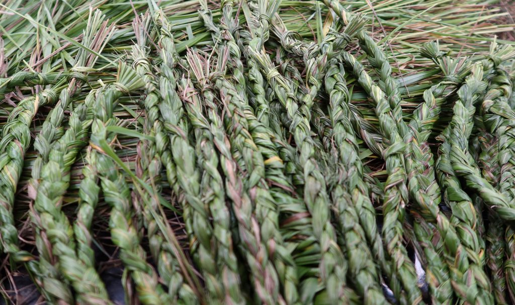 a pile of sweetgrass braids