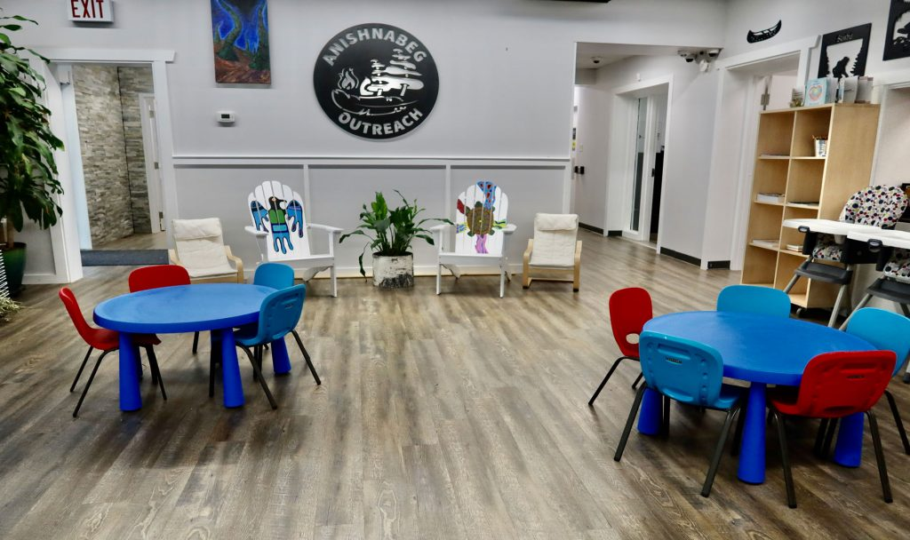 Earlyon centre with tables and chairs and our logo on the wall