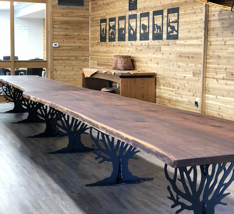 two long wood tables in the great room of the Kitchener location