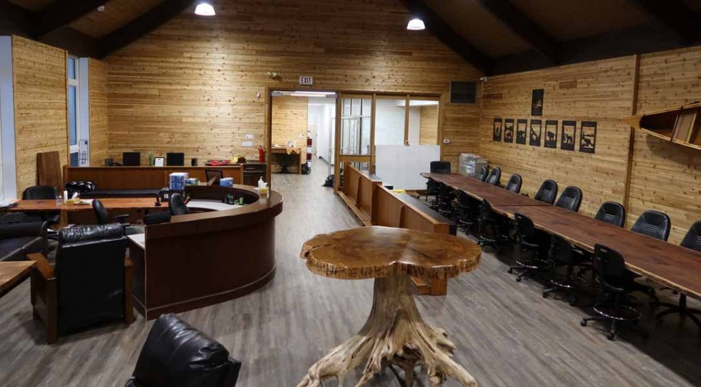 The great room at the Kitchener office with wooden tables and chairs. for clients and workers.