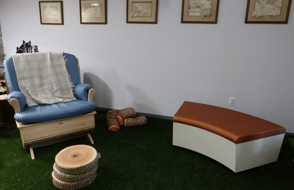 Circle created with rocking chair and other chairs