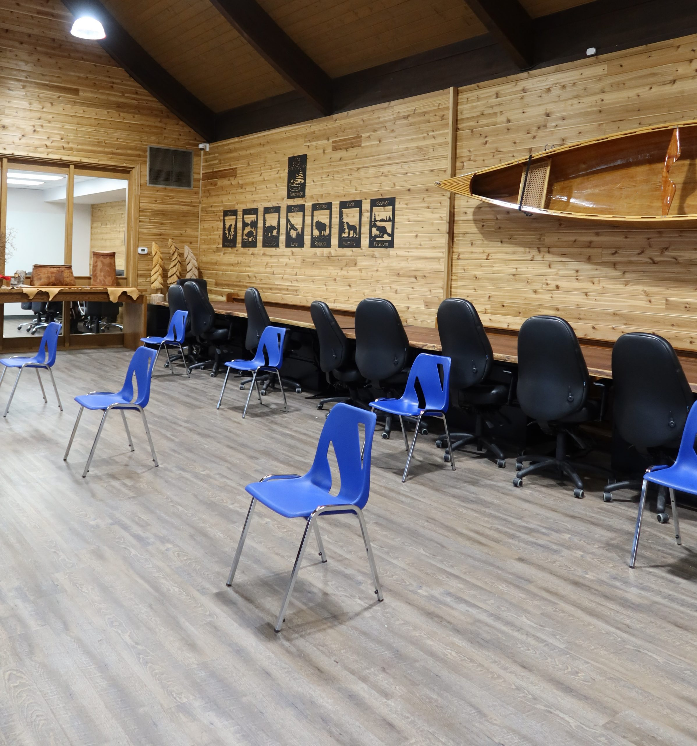 recover room for pop-up vaccine clinic with blue chairs set up six feet apart