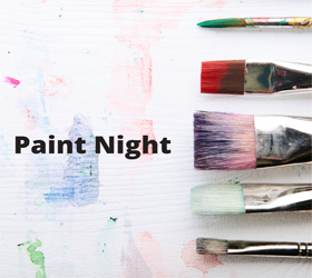 paint brushes on a canvas with paint