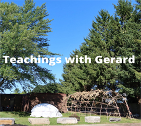 Healing and teaching lodges with a maple tree to the left